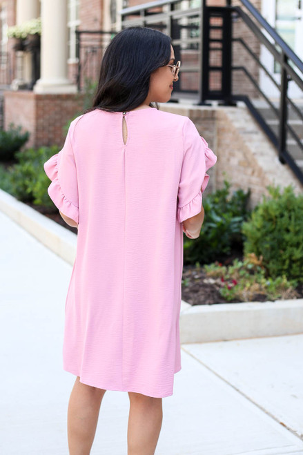 Model wearing Mauve Ruffle Sleeve Dress Back View