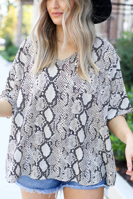 Model wearing Taupe Oversized Snakeskin Blouse Detail View