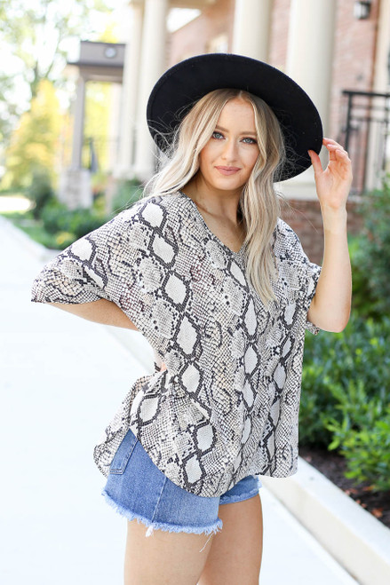 Model wearing Taupe Oversized Snakeskin Blouse Side View