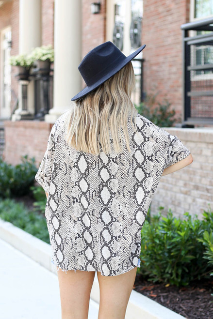 Model wearing Taupe Oversized Snakeskin Blouse Back View