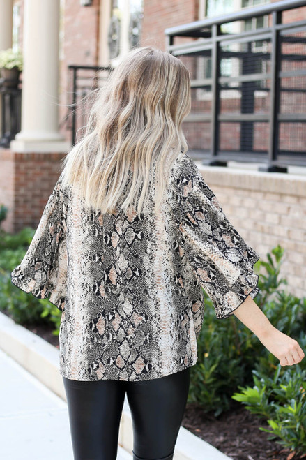 Model wearing Taupe Oversized Snakeskin Ruffle Sleeve Top Back View