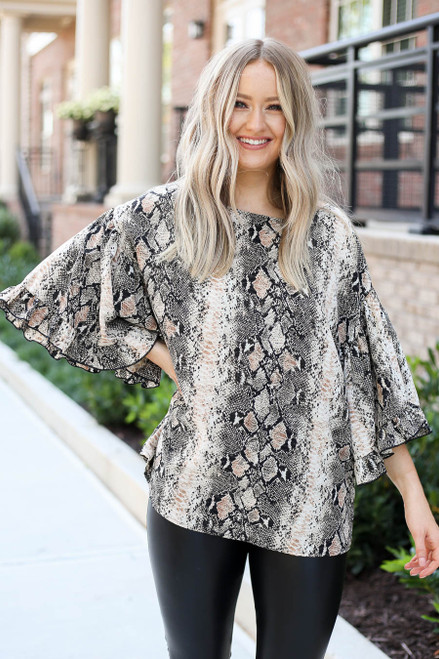 Model wearing Taupe Oversized Snakeskin Ruffle Sleeve Top Front View