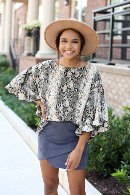 Model wearing Taupe Oversized Snakeskin Ruffle Sleeve Top and Skirt Tucked In