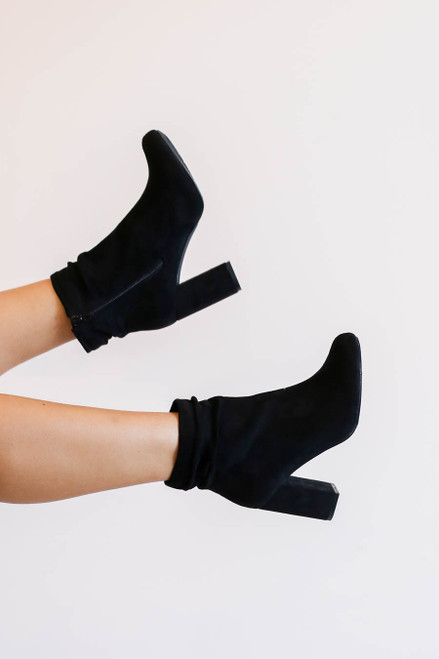 Model wearing Black Block Heel Slouch Booties