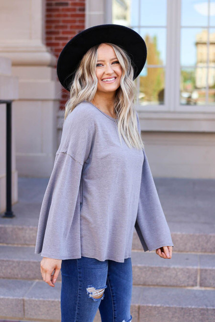 Grey - Model wearing the Halston Oversized Knit Top Side View