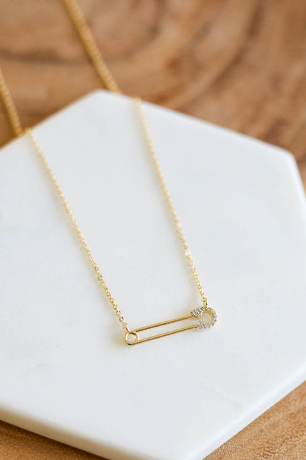 Gold - Rhinestone Safety Pin Necklace Flat Lay