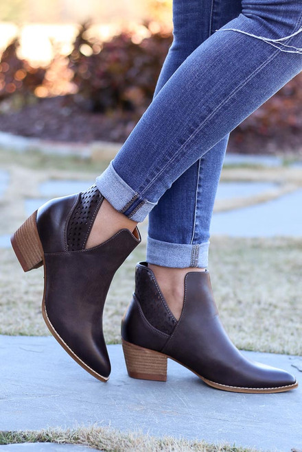 Brown - Laser cut ankle booties on model
