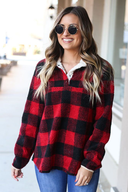 Red - Buffalo Plaid Sherpa Pullover on Model styled with high rise jeans from Dress Up