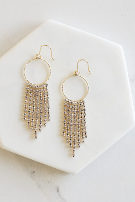 Flat Lay of Hoop and Rhinestone Drop Earrings from Dress Up