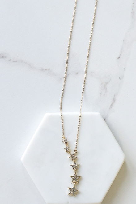 Gold - Flat Lay of the Rhinestone Star Pendant Necklace from Dress Up
