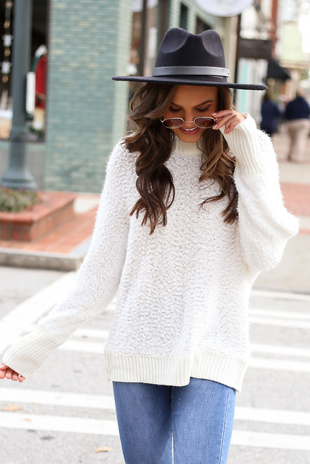 Model wearing the White Oversized Popcorn Eyelash Knit Sweater with wide brim hat from Dress Up Front View