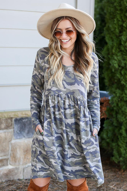 Camo - Model wearing the Camo French Terry Babydoll Dress from Dress Up Boutique with wide brim hat Front View