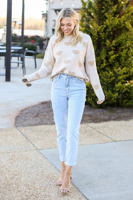 Model wearing the Light Wash High Rise Skinny Jeans with a knit sweater and heels from Dress Up