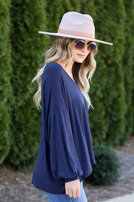 Navy - Jersey Knit Balloon Sleeve Top Side View with wide brim hat