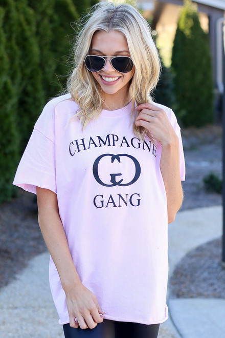 Model wearing the Champagne Gang Graphic Tee from Dress Up in Size Large Close Up Front View