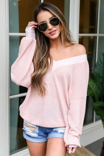 Blush - Model wearing the Oversized Waffle Knit Contrast Top with denim shorts