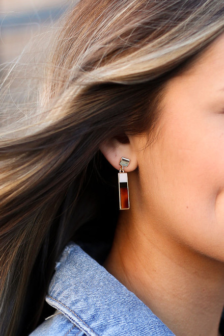 Rust - Model wearing the Bar Drop Earrings