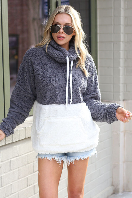 Charcoal - Dress Up model wearing the Sherpa Cowl Neck Pullover with denim shorts