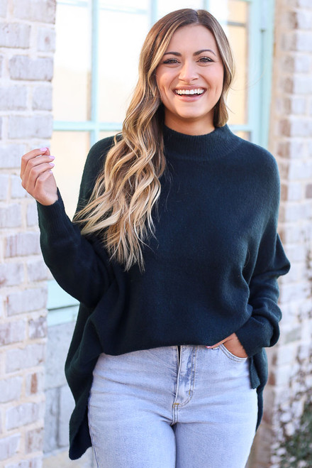 Green - Model wearing the Brushed Knit Oversized Top in Green tucked into light wash jeans