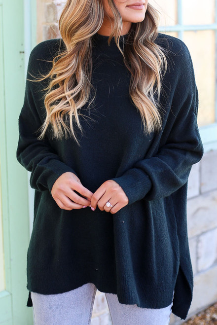 Green - Close Up of a Dress Up model wearing the Brushed Knit Oversized Top with light wash jeans