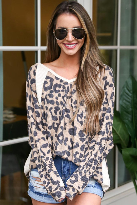 Taupe - Model wearing the Leopard Waffle Knit Oversized Top with medium wash jean shorts and sunglasses from Dress Up  Boutique Front View