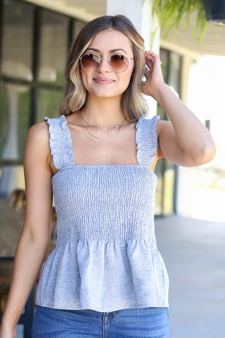 Navy - smocked peplum top