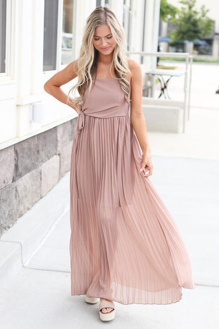 Taupe - Dress Up model wearing the Front Tie Pleated Maxi Dress