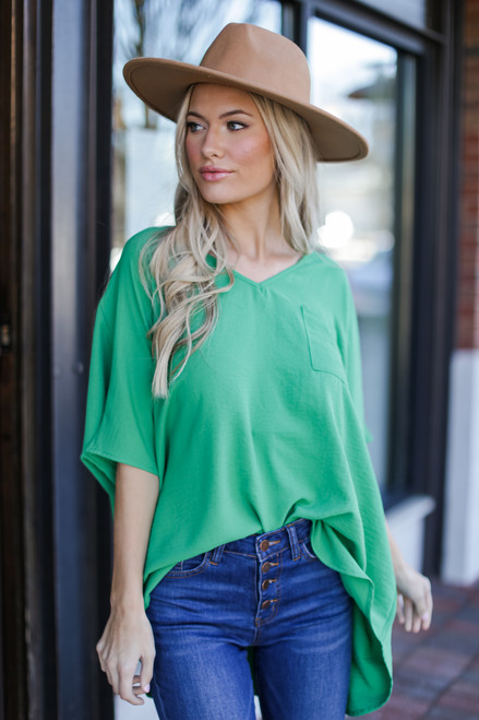 Green - Model wearing the Oversized Blouse with skinny jeans