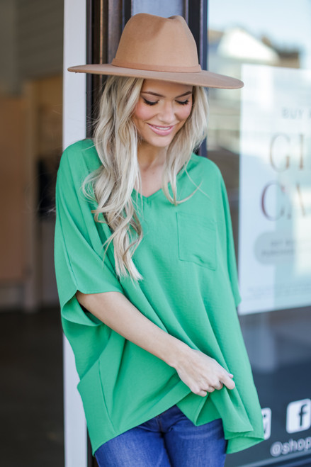 Green - Dress Up model wearing the Oversized Blouse with skinny jeans