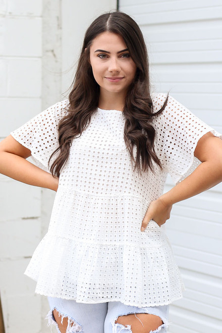 White - Model wearing the Eyelet Tiered Babydoll Top