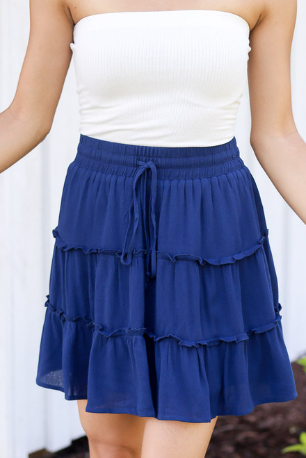 Navy - close up of tiered skirt with white bodysuit