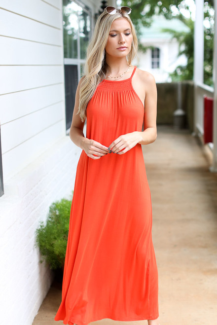 Red - Model wearing the Smocked High Neck Maxi Dress with slip on sandals