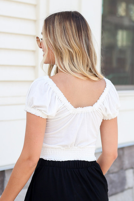 White - Close Up of the Button Back Crop Top