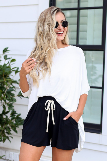 White - cute oversized tunic paired with black lounge shorts