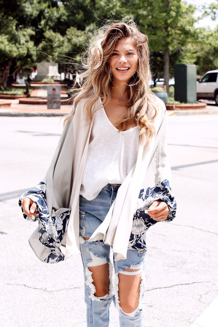 Sage -  Model wearing a Floral Kimono with a smocked crop top and denim shorts