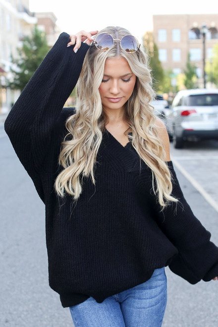 Black - Model wearing an Oversized Sweater