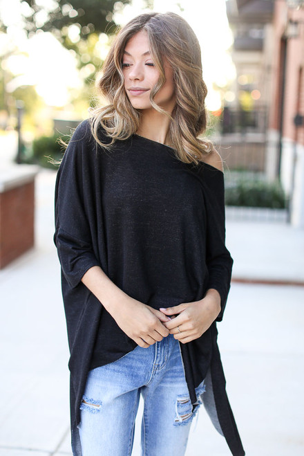 Black - Model wearing a Soft Knit Oversized Top with light wash jeans