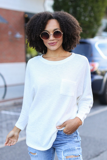 White - Model wearing a Textured Oversized Top with distressed jeans