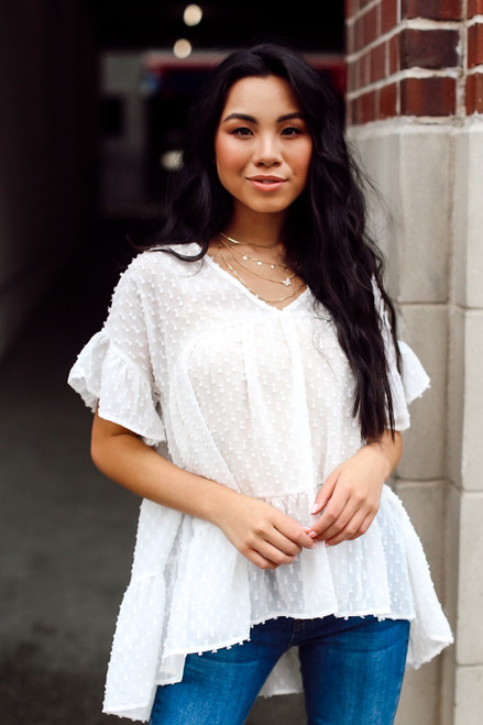 White - Dress Up model wearing a Swiss Dot Tiered Babydoll Blouse