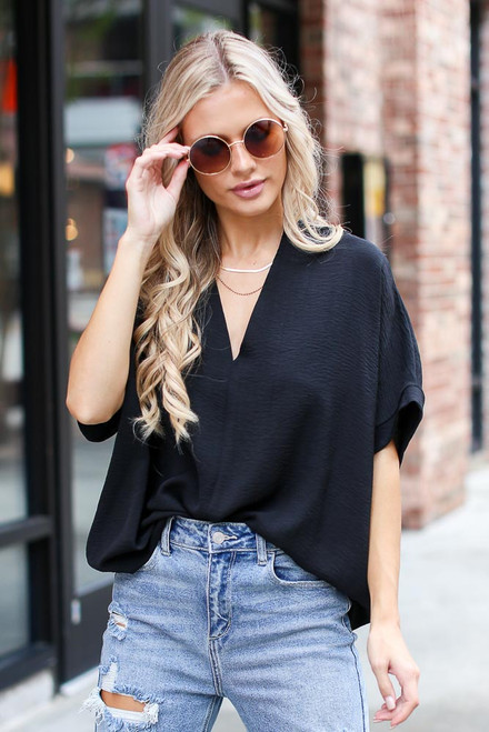 Black - Dress Up model wearing a Textured Oversized Blouse with skinny jeans