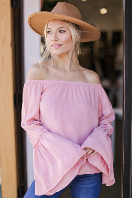 Blush - Model wearing a Bell Sleeve Off-the-Shoulder Top