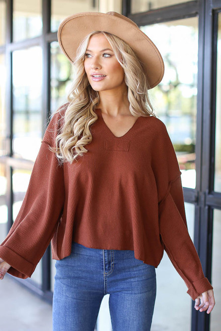 Camel - Model wearing an Oversized Waffle Knit Top with a wide brim hat