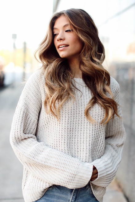 Taupe - Dress Up model wearing an Oversized Chenille Sweater with light wash jeans