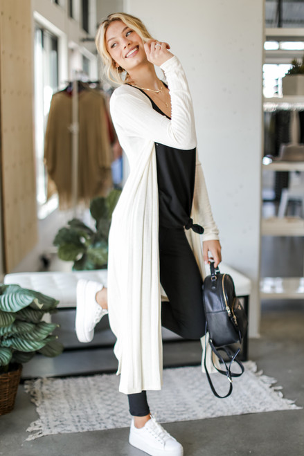 Ivory - Dress Up model wearing a Knit Duster Cardigan with a black bodysuit