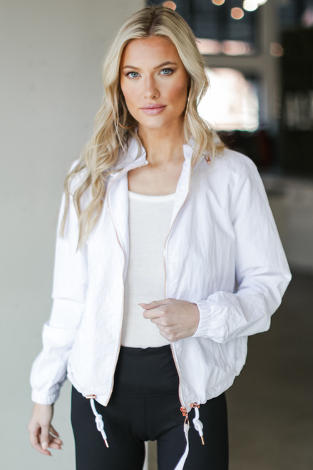 White - Model wearing a Hooded Windbreaker Jacket