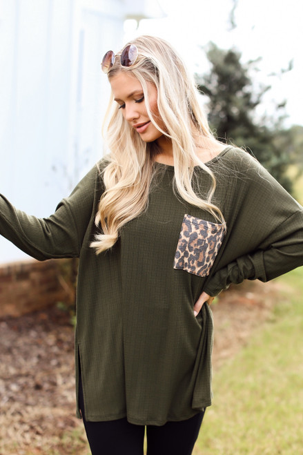Olive - Model wearing an Oversized Front Pocket Top with black jeans
