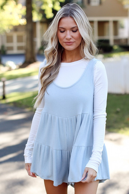 Blue - Model wearing a Ribbed Knit Tiered Romper with a white undershirt