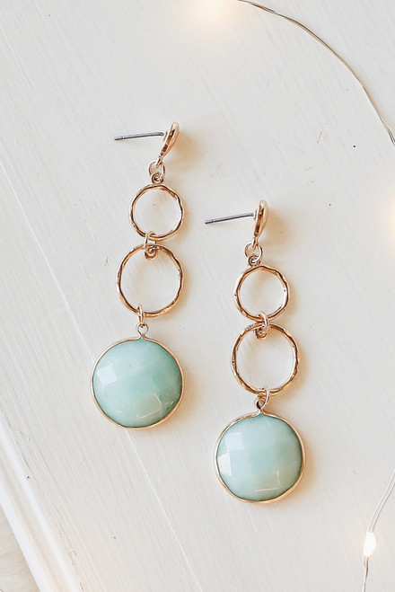 Mint - Flat Lay of Gold Statement Drop Earrings on a white background