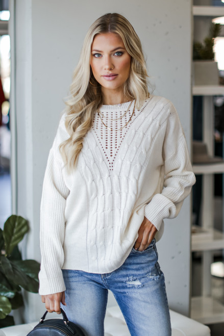 Ivory - Dress Up model wearing a Cable Knit Sweater with jeans