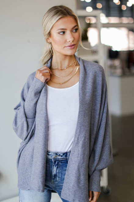 Denim - Model wearing a Soft Knit Cardigan with a bodysuit
